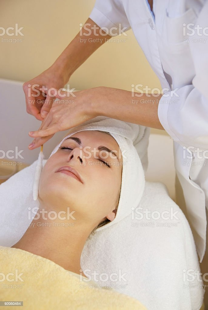 Facial cryogenic massage in spa salon royalty-free stock photo