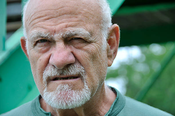 facial expression of an elderly male - mike cherim stock pictures, royalty-free photos & images