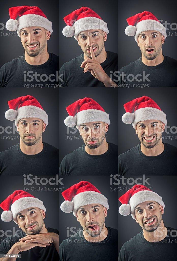 Facial expression set of young man wearing santa hat royalty-free stock photo