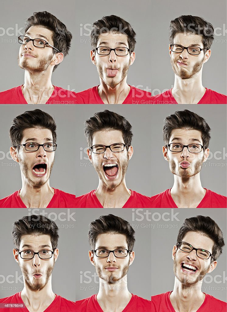Facial expressions, multiple image Multiple image of young man with variety of facial expressions. Studio shot on grey background. Adult Stock Photo