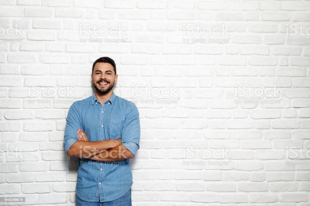 Facial Expressions Of Young Beard Man On Brick Wall royalty-free stock photo