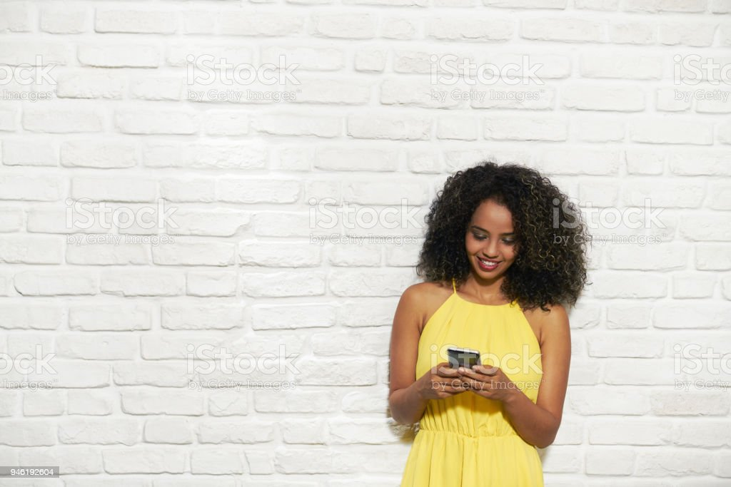 Facial Expressions Of Young Black Woman On Brick Wall royalty-free stock photo