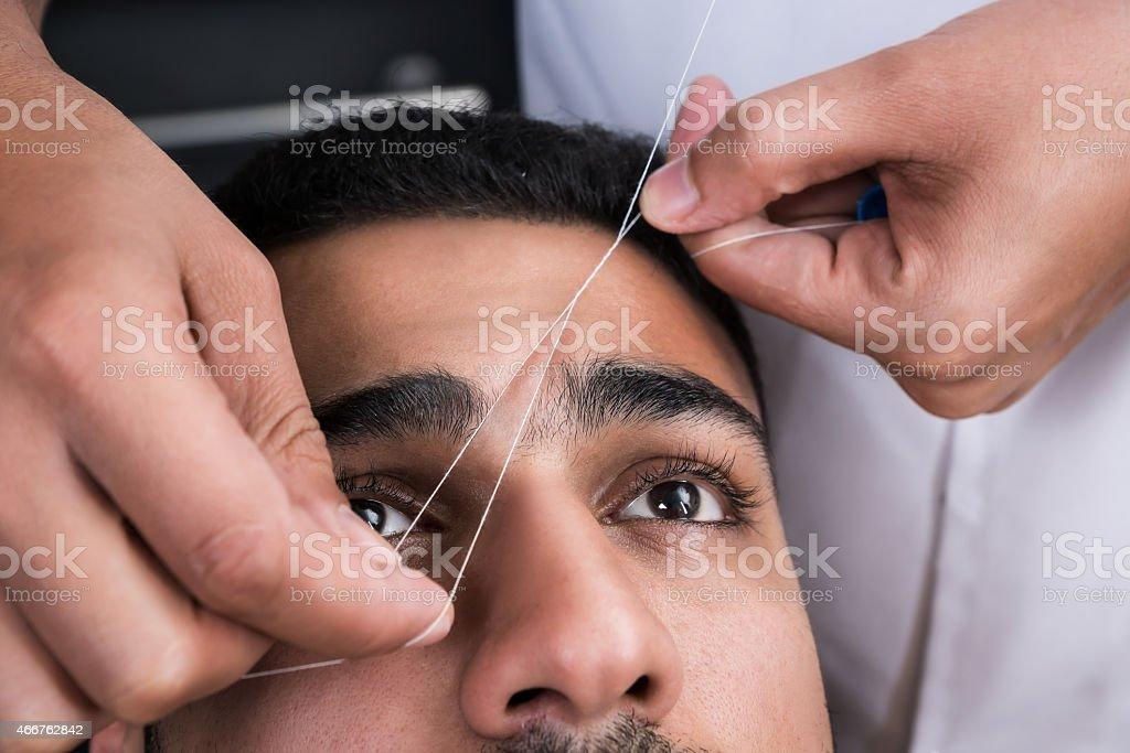 Facial hair removal stock photo