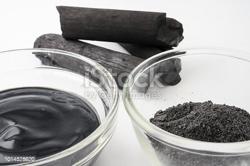 istock Facial mask and scrub by activated charcoal powder on white background 1014528620