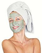young beauty woman getting facial mask