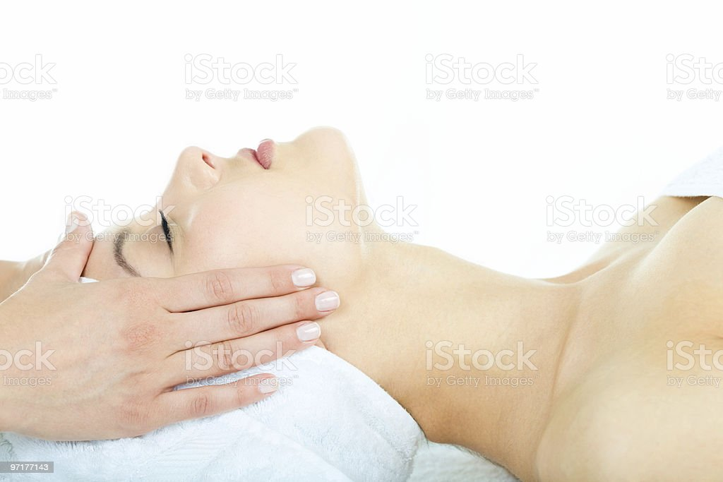 Facial massage given by a professional royalty-free stock photo