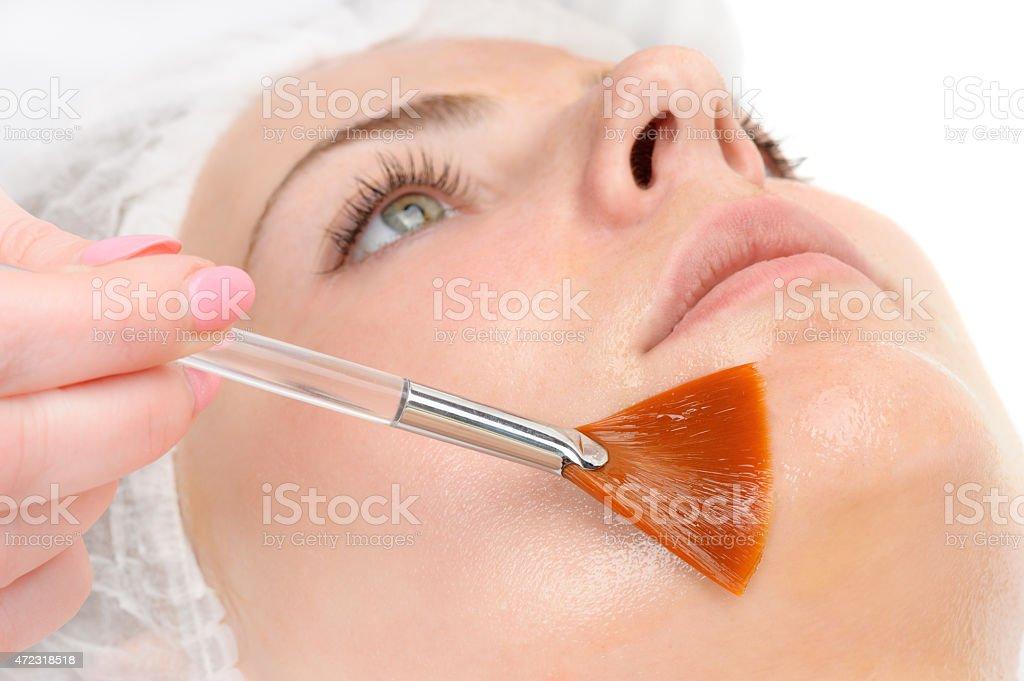 facial peeling mask applying stock photo