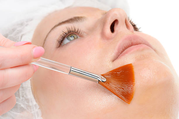facial peeling mask applying stock photo