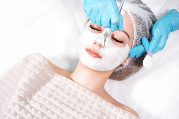 facial pilling treatment background with a young woman - chemical peel stock pictures, royalty-free photos & images