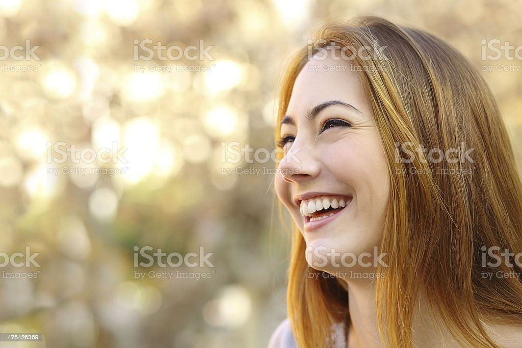 Facial portrait of a funny woman face laughing stock photo