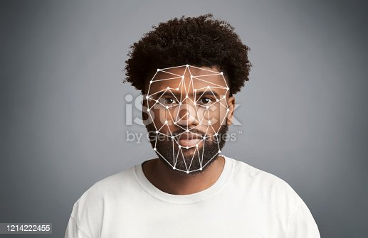1021681352 istock photo Facial recognition. African American man with polygonal mesh on his face against grey background 1214222455