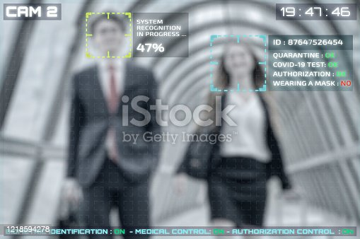 istock Facial recognition simulation of people with covid-19 test verification 1218594278