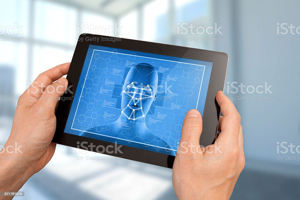 Facial recognition surveillance system on tablet stock photo