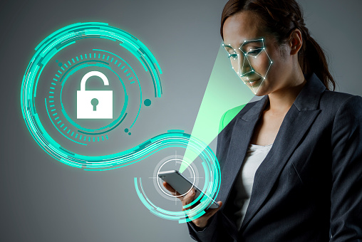 istock Facial Recognition System of smart phone. Biometrics concept. 858527030
