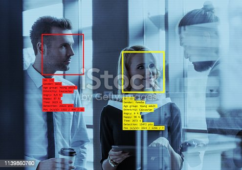 Facial Recognition System in the office. Business people having lunch time.