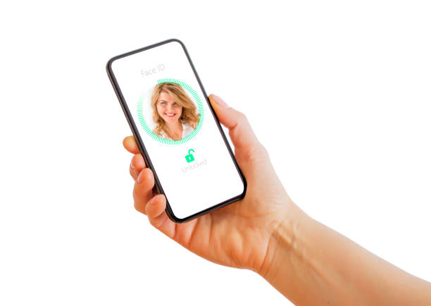 Facial recognition technology on mobile phone. stock photo