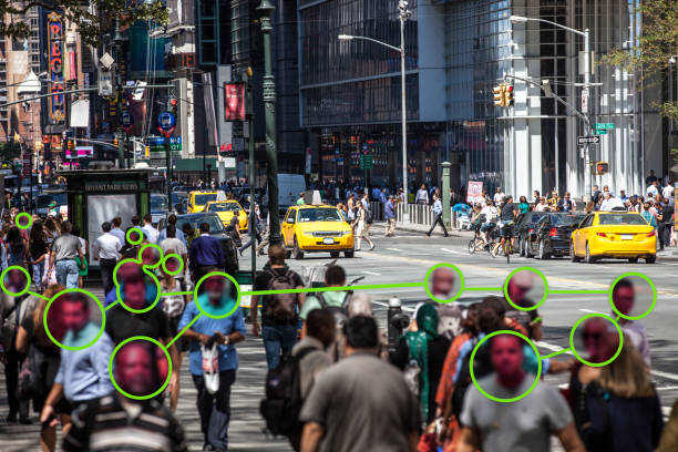 Facial Recognition technology used to prevent Covid-19 spread Facial Recognition technology used to prevent Covid-19 spread.  Note for inspectors: people is a crowd, cars are edited even if not necessary. terrorism stock pictures, royalty-free photos & images