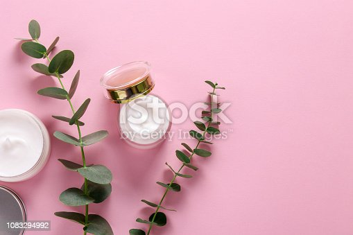 istock Facial skin care cream for woman. 1083294992