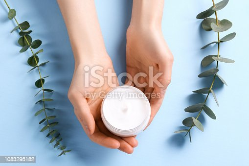 istock Facial skin care cream for woman. 1083295182