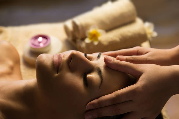 facial spa massage - spa treatment stock photos and pictures