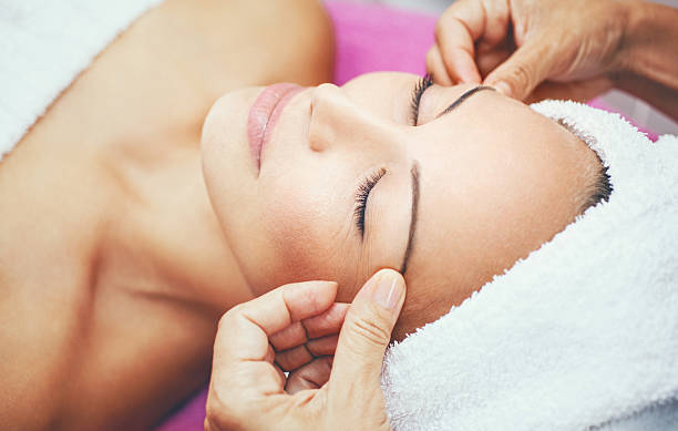 facial treatment at beauty salon. - beautician stock photos and pictures
