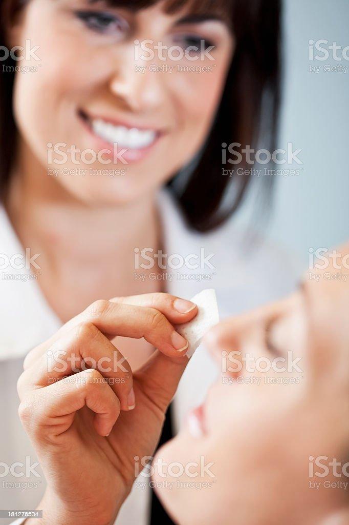 Facial treatment at beauty spa stock photo