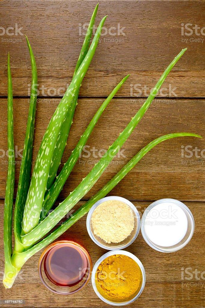 Facial Treatment Recipe with Fresh Aloe Vera on Wood Background. stock photo
