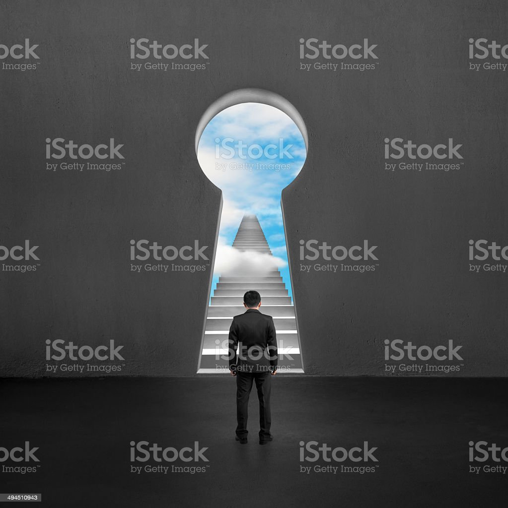 Facing key shape door with stairs and sky outside stock photo