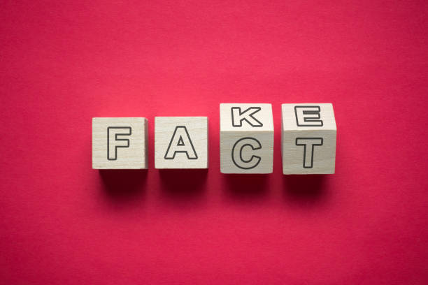 Fact and fake confusion Confusion between fact and fake news using wooden cubes information equipment stock pictures, royalty-free photos & images