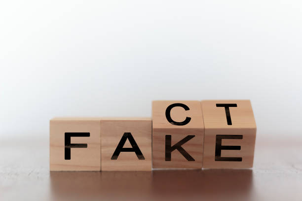 Fact and fake on words on wooden cubes Fact and fake on words on wooden cubes dishonesty stock pictures, royalty-free photos & images