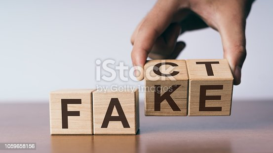 istock Fact or Fake concept, change wooden cube 1059658156