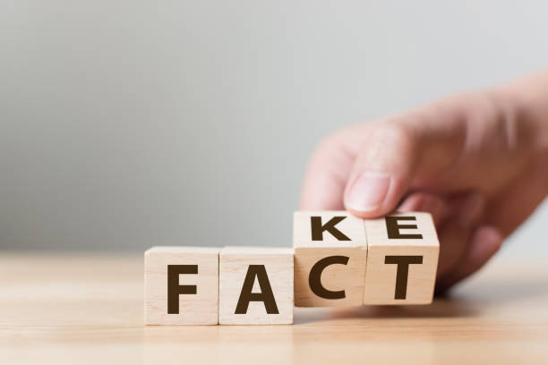 Fact or Fake concept, Hand flip wood cube change the word, April fools day Fact or Fake concept, Hand flip wood cube change the word, April fools day information equipment stock pictures, royalty-free photos & images