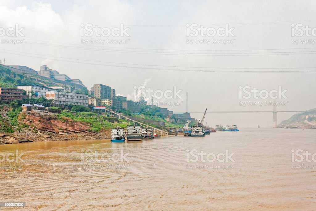 Factories on the banks of the Yangtze River on a hazy morning stock photo