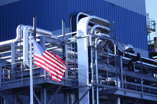 This industrial manufacturing plant flies the american flag out front proudly