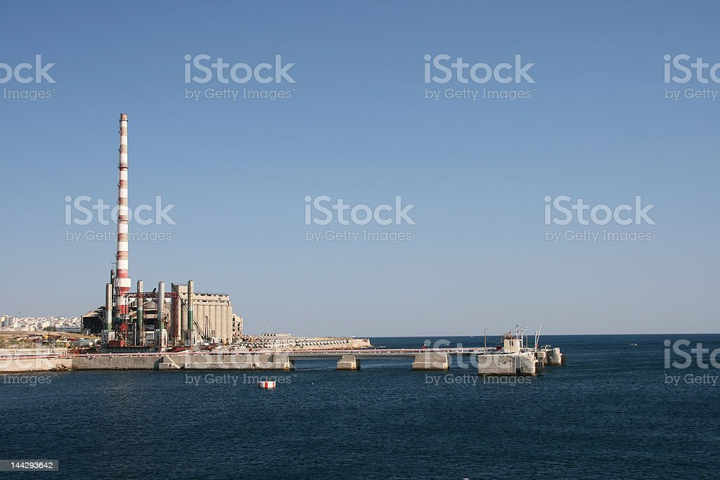 factory by the sea royalty-free stock photo