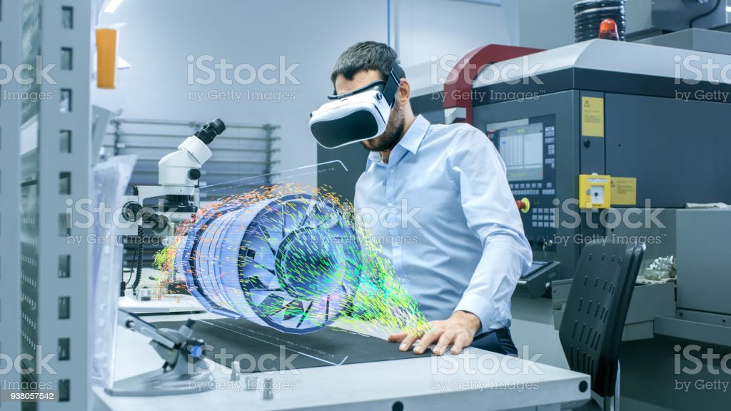 Factory Chief Engineer Wearing VR Headset Designs Engine Turbine on the Holographic Projection Table.  Futuristic Design of Virtual Mixed Reality Application. stock photo