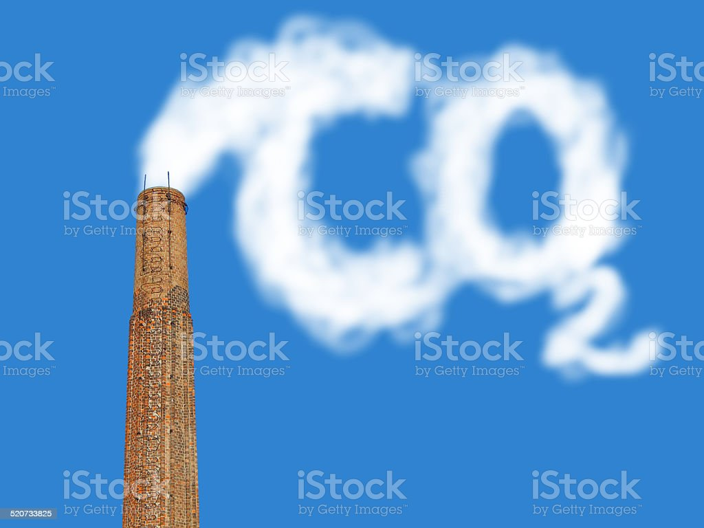 factory chimney with symbolic emission stock photo