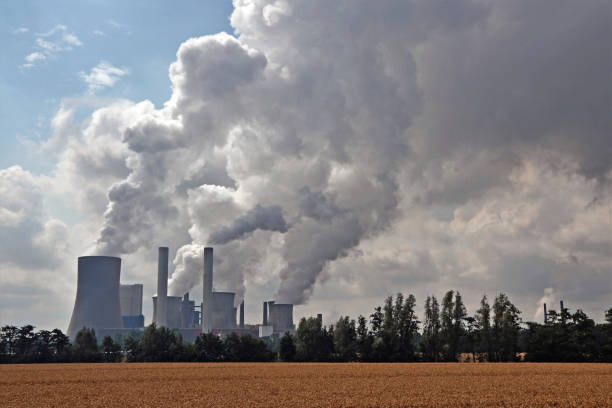 Factory chimneys emitting air pollutions stock photo