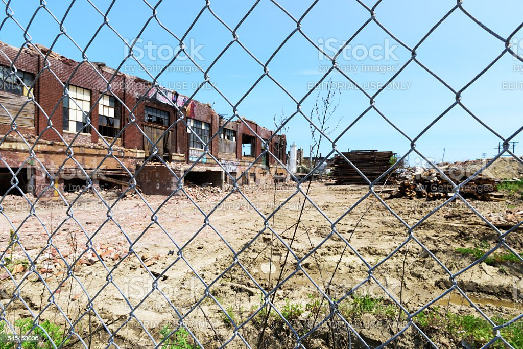 Factory demolition   through chainlink  fence stock photo