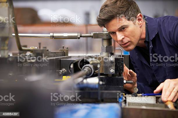 Close Up Of Factory Engineer Operating Hydraulic Tube Bender