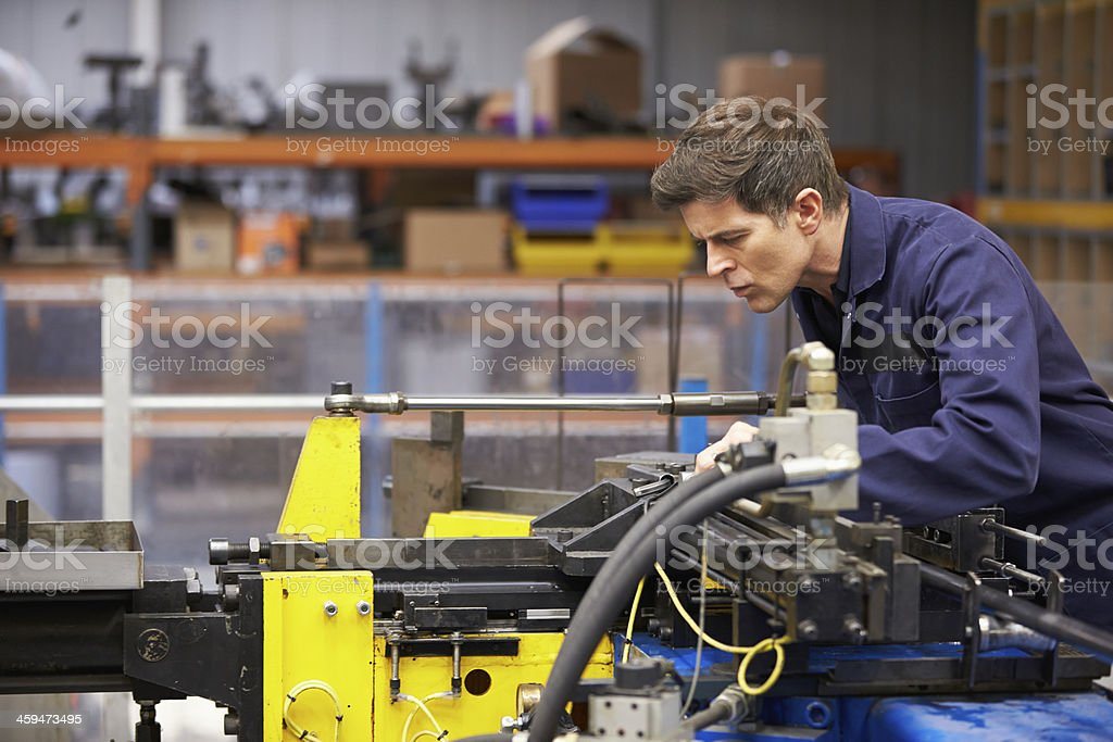 Factory Engineer Operating Hydraulic Tube Bender stock photo