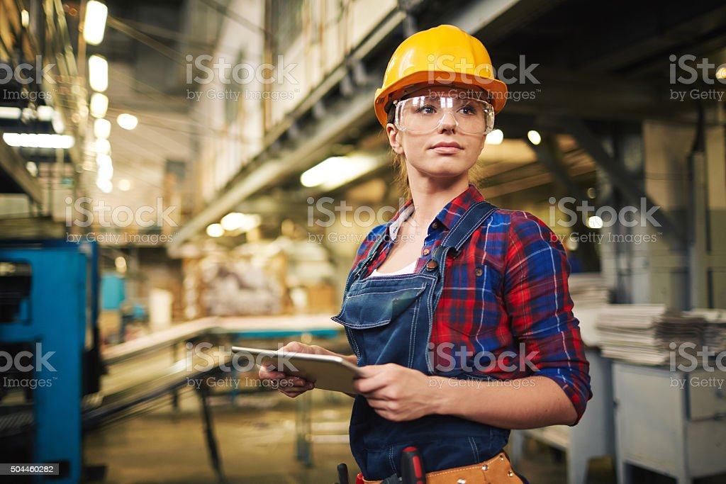 Factory female worker stock photo