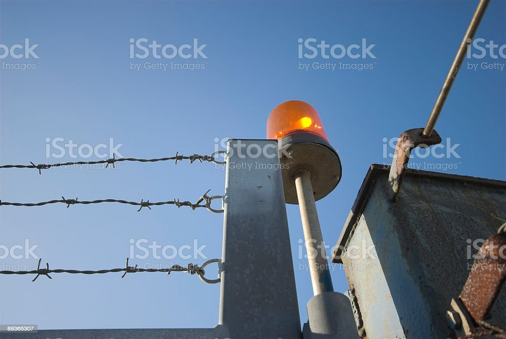 Factory Fence and Red Alarm royalty-free stock photo