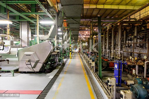 Equipment and machines used in the production of aluminium metal. Industrial processes on the factory floor.
