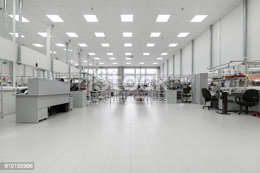 istock Factory for the manufacture of electronic printed circuit boards. Workshop surface mounting and pre-assembly 910155996