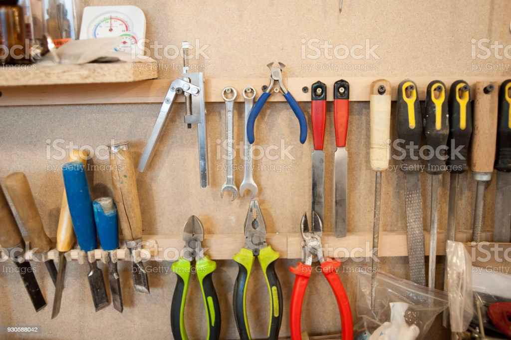 factory for the production of bent wood products. Tools for processing and gluing. Manufacture of guitars and stringed musical instruments. stock photo