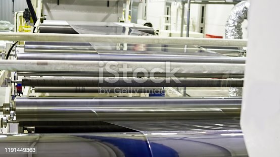 513948652 istock photo Factory from the inside.  Industrial building interior. Plant for the production of plastic film. 1191449363