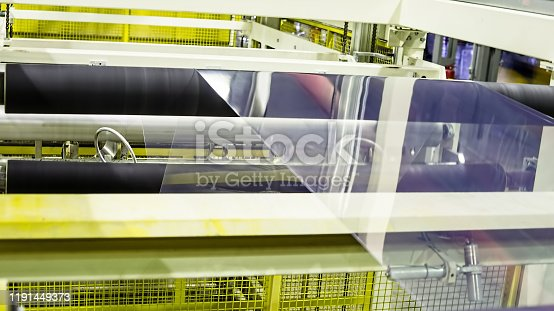 513948652 istock photo Factory from the inside.  Industrial building interior. Plant for the production of plastic film. 1191449373