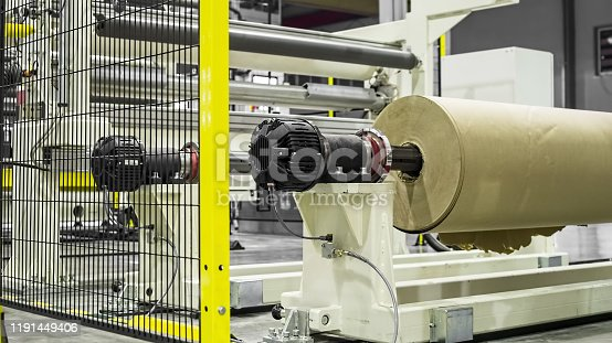 513948652 istock photo Factory from the inside.  Industrial building interior. Plant for the production of plastic film. 1191449406