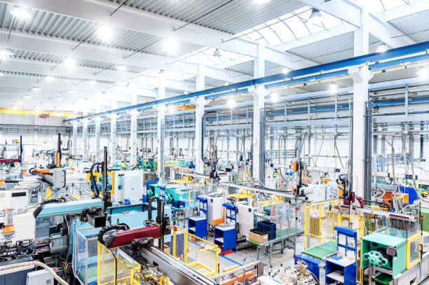 Factory interior & futuristic machines stock photo
